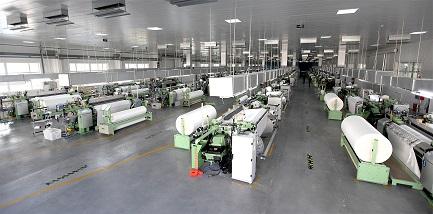 Wartungsarm, effizient, langlebig: DORNIER Greiferwebmaschinen-Anlage zur Herstellung von Präzisionsfiltergewebe zur Nass-, Feststoff und Luftfiltration
