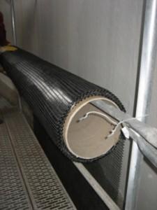 Instandsetzung mit textilbewehrtem Beton: An einem Silo der Nordzucker AG kam Textilbeton mit Carbonfaserbewehrung im Rahmen einer großflächigen Sanierung zum Einsatz. Dabei wurde Textilbeton mit vier Lagen Carbontextil aufgebracht; insgesamt wurden rund 14.000 Quadratmeter 2-D-Textil sowie 150 Tonnen Feinbeton verbaut. Circa 3.100 Quadratmeter Sanierungsfläche wurden so instandgesetzt.